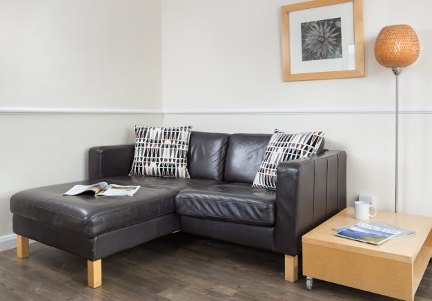 Comfy sofa for two in our Keswick self catering apartment.