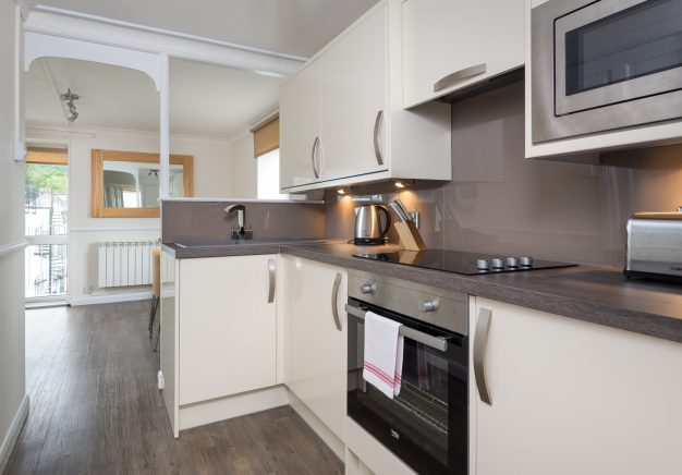 Modern, newly refurbished kitchen in our Keswick self catering apartment.