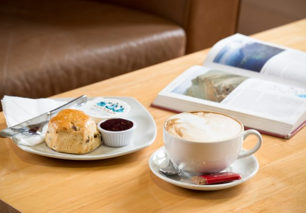 Relax with a cup of coffee and a book in our cafe