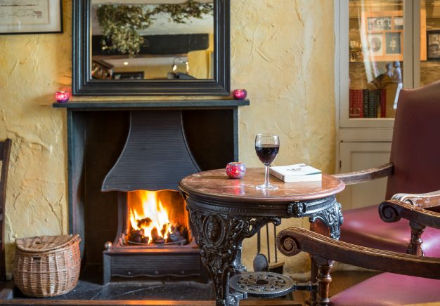 Relax by the open fire at Traveller's Rest Grasmere