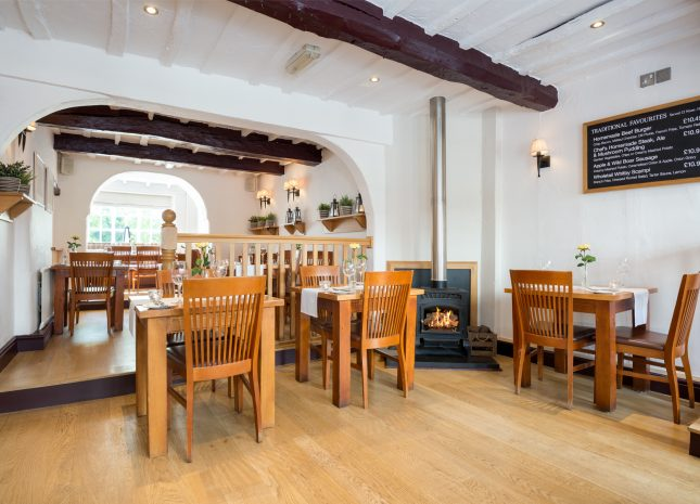 Upstairs restaurant with a woodburner